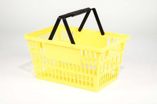 Large yellow plastic shopping basket with double black handgrips