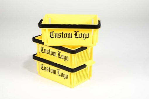 Three yellow mini baskets with black logo